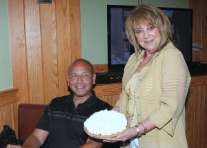 Owner Linda DeWese showing off one of their famous pies with Ed Garza, a former mayor of San Antonio.